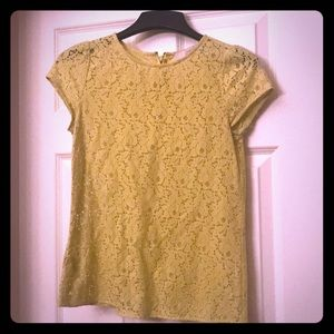 Short sleeved, lace top. Color is chartreuse.